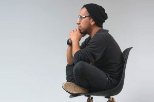 man thinking on chair