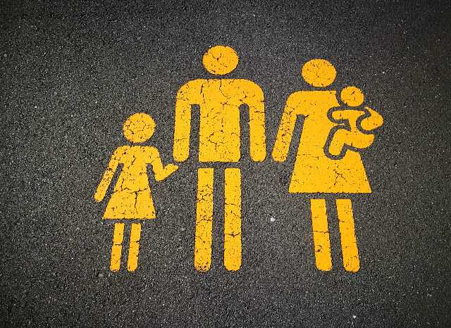 image of family on road surface