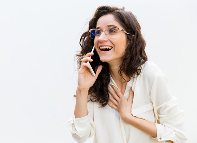 woman getting good news on phone