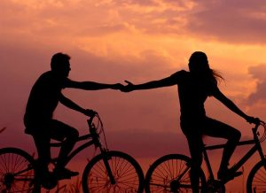 silhouette of couple riding bicycles