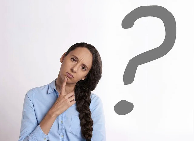 woman thinking near question mark