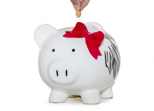 adding money to piggy bank