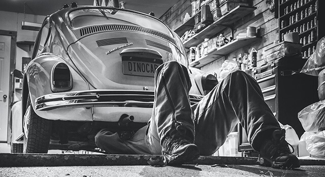black and white working on car