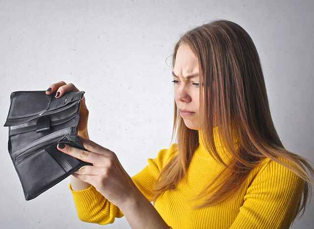 woman looking in wallet