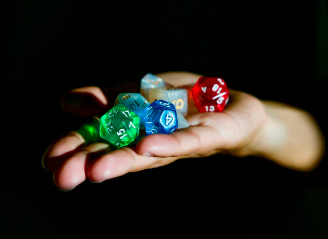 coloured dice in hand