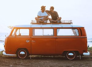 friends talking on vw bus