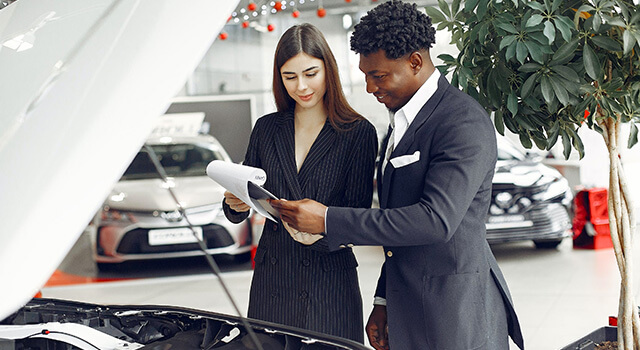 man and woman looking in dealership