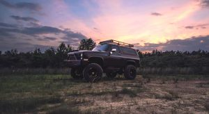 SUV with sunset background