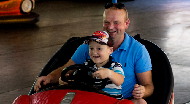 man and son on dodgem car